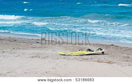 Surfboard On The Foreshore