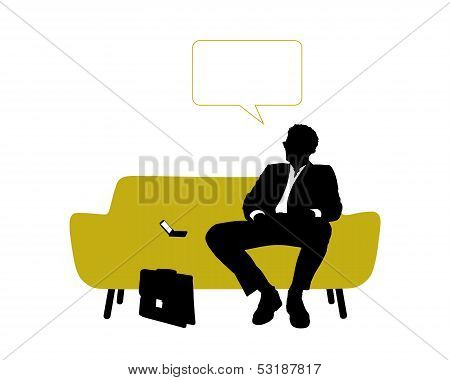 Businessman Seated On Yellow Sofa Having Rest And Thinking