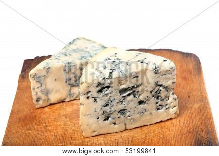 Dorblu Cheeses On Old Wooden Kitchen Board