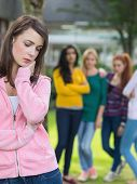 image of down jacket  - Female student being bullied by other group of students - JPG