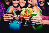 foto of fingernail  - Glasses with cocktails held by happy friends at party - JPG