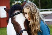 stock photo of iceland farm  - Closeup of an icelandic horse with girl - JPG