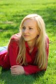Beautiful Blonde Lies On Grass