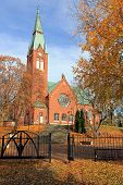 image of neo-classic  - The Forssa Church Finland on a beautiful day of autumn. The church is a Neo-Gothic cruciform church and it was built 1914 - 1917.