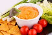 foto of nachos  - Nachos cheese sauce cherry tomatoes and lettuce closeup image.