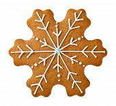 stock photo of ginger bread  - Gingerbread cookie in snowflake shape isolated on white background - JPG