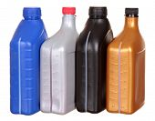 image of lube  - Plastic bottles from automobile oils isolated on a white background - JPG
