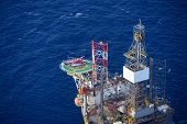 stock photo of helicopters  - Top view of helicopter embark passenger on the offshore oil rig - JPG