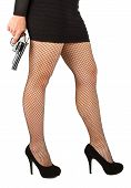 pic of fishnet stockings  - Legs of dangerous woman with handgun and black shoes fishnet stockings - JPG
