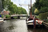 foto of flatboat  - View on typical canal with different boats and white drawbridge - JPG