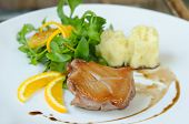 stock photo of duck breast  - close up duck breast served with mashed potatoes slice of orange and fresh salad - JPG