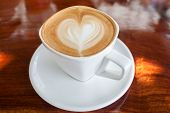 foto of latte  - Cup of latte coffee on wood table - JPG