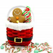 stock photo of ginger man  - Gingerbread Man and Christmas candy in a red basket - JPG