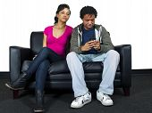 stock photo of envy  - jealous lover snooping on cell phone text conversations - JPG