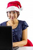 image of long distance relationship  - young Asian female working or on a webcam chat during Christmas - JPG