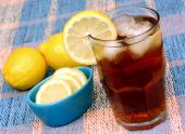 stock photo of iced-tea  - Ice tea with a lemon slice on glass rim - JPG