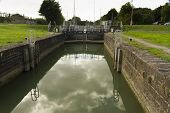 picture of coal barge  - One of two sets of locks that allow access by boat to the River Severn this is above the semi  - JPG