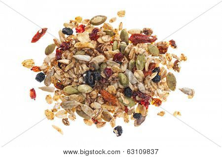 Pile of homemade granola with various seeds and berries shot from above isolated on white background