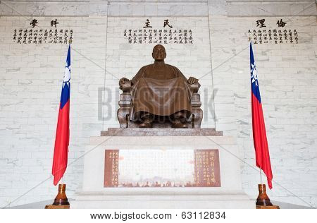 TAIPEI, TAIWAN-March 16: The large bronze statue of Chiang Kai-shek on March 16,2014 in Taipei, Taiwan. This bronze statue dominates the main hall of the CKS memorial hall.