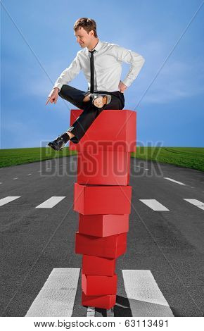 Successful Business Man On The Top Of Pyramid Made Of Red Boxes With Scorn And Pride Looks Down On T