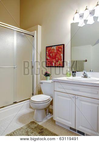 Cozy Bathroom With White Vanity