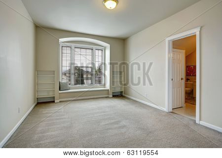 Empty Room With Arch Window And Bench