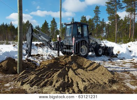 Excavator Digs Pillar Pylon