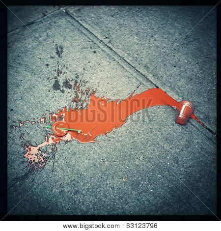 Instagram style image of a discarded smoothie on the city sidewalk
