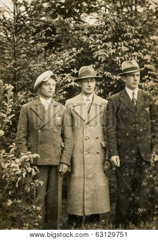 GERMANY, CIRCA 1940's: Vintage photo of three men in hats