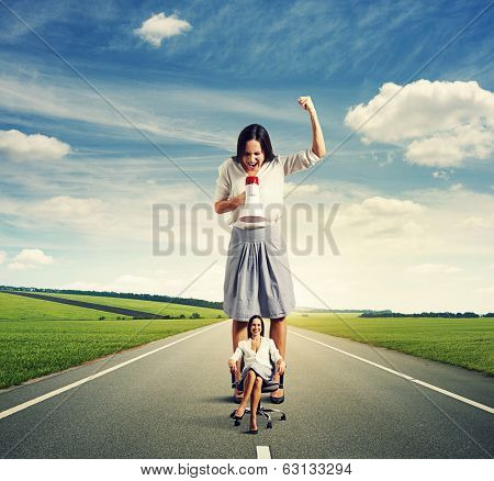 discontented woman and smiley woman on the road