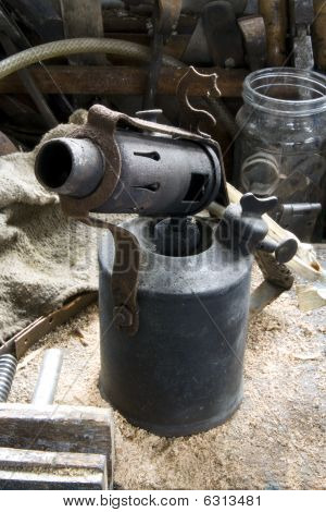 Antique Blow Lamp On Workbench