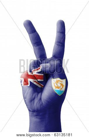 Hand Making The V Sign, Anguilla Flag Painted As Symbol Of Victory, Win, Success - Isolated On White