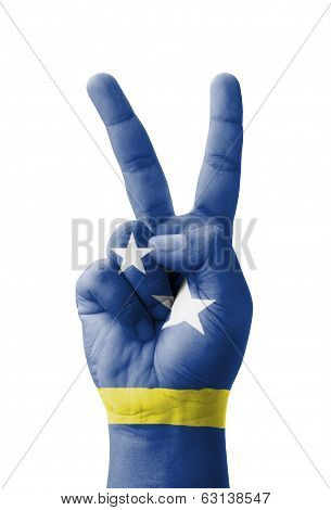 Hand Making The V Sign, Curacao Flag Painted As Symbol Of Victory, Win, Success - Isolated On White