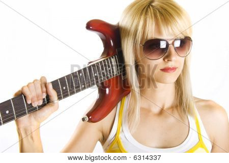 woman with guitar on shoulder