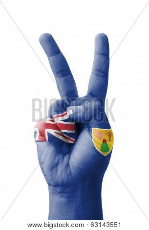 Hand Making The V Sign, Turks And Caicos Islands Flag Painted As Symbol Of Victory, Win, Success - I