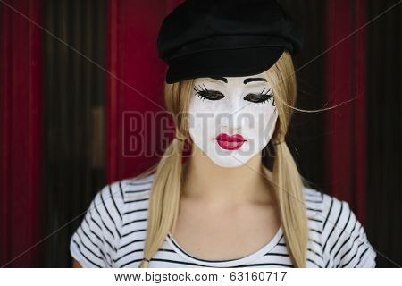 sad mime with black hat on the red background