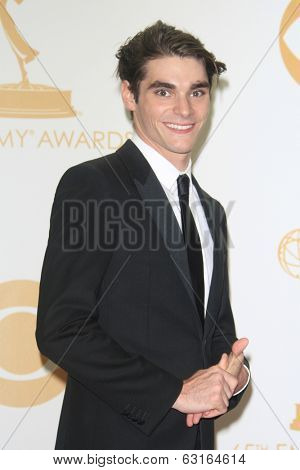 LOS ANGELES - SEP 22: RJ Mitte in the press room during the 65th Annual Primetime Emmy Awards held at Nokia Theater L.A. Live on September 22, 2013 in Los Angeles, California