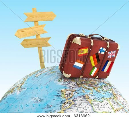 Concept trip. Suitcase on the globe and pointer