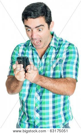 Angry man yelling at his mobile phone (isolated on white)