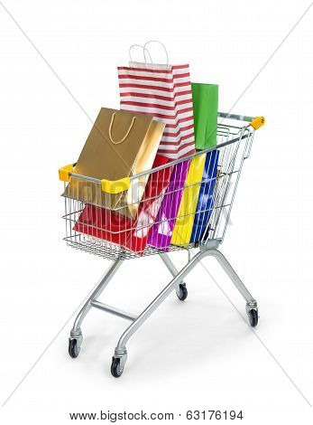 shopping in trolley with colorful bags isolated on white