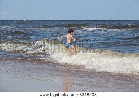 Boy Chasing A Waves