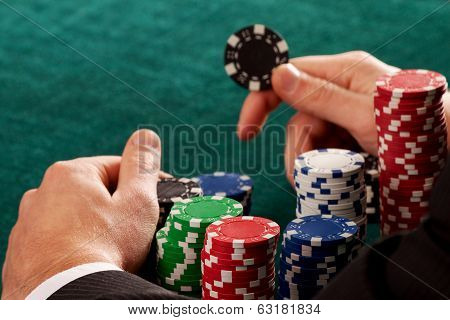 Holding A Casino Chip