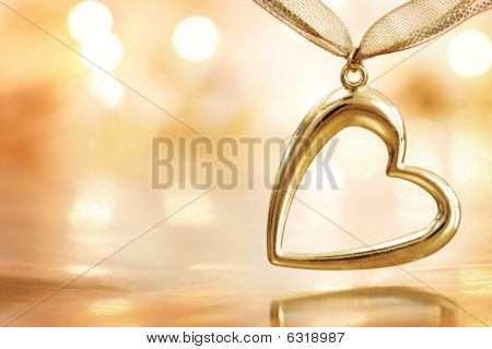 Golden Heart On Blazing Defocused Lights Background