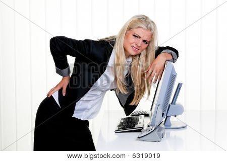 Frustrated Businesswoman Leaning On Computer Monitor