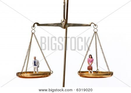 Man And Woman Figurines On Scales