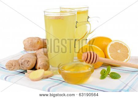 Healthy ginger tea with lemon and honey on table close-up