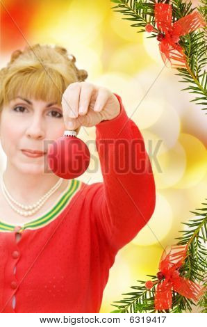 Merry Christmas with woman giving red bauble