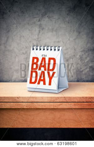 It's A Bad Day Printed On Desk Calendar At Office Table