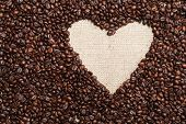 stock photo of sackcloth  - Heart coffee frame made of coffee beans on burlap texture - JPG