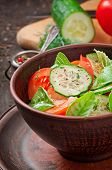 foto of lenten  - Tomato and cucumber salad with black pepper and basil - JPG